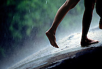 Barefoot in summer rains that come daily in South Florida.