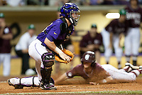 LSU Tigers catcher Ty Ross #26 blocks a throw while Mississippi State Bulldog baserunner Phillip Casey scores in the 9th inning of the NCAA baseball game on March 17, 2012 at Alex Box Stadium in Baton Rouge, Louisiana. The 10th-ranked LSU Tigers beat #21 Mississippi State, 4-3. (Andrew Woolley / Four Seam Images).