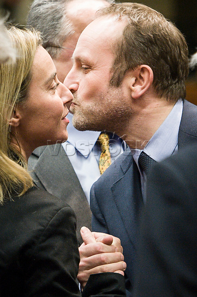 Federica Mogherini , EU High representative for foreign policy (L) kisses Denmark's Foreign Affairs Minister Martin Lidegaard  prior to the European Union Foreign Ministers Council at EU headquarters  in Brussels, Belgium on 29.01.2015 Federica Mogherini , EU High representative for foreign policy called extraordinary meeting on the situation in Ukraine after the attack on Marioupol.  by Wiktor Dabkowski