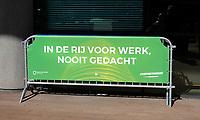 Nederland - Rotterdam- 2020.  World Port Center. Spandoek met de tekst: In de rij voor werk, nooit gedacht.  TISFFNIETANDERS.  Foto ANP / Hollandse Hoogte / Berlinda van Dam