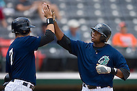 Brandon Allen #41 of the Charlotte Knights his high fived by teammate Josh Kroeger #7 after hitting a home run at Knights Castle June 22, 2009 in Fort Mill, South Carolina. (Photo by Brian Westerholt / Four Seam Images)