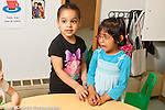 Education Preschool 3 year olds girl noticing and trying to help sad classmate