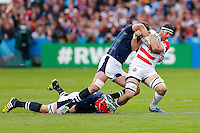 Japan Lock Luke Thompson is tackled by Scotland Lock Grant Gilchrist and Flanker Ryan Wilson - Mandatory byline: Rogan Thomson - 23/09/2015 - RUGBY UNION - Kingsholm Stadium - Gloucester, England - Scotland v Japan - Rugby World Cup 2015 Pool B.