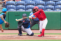 Clearwater Threshers Freddy Francisco (55) bats in front of catcher Carlos Narvaez (5) and umpire Rainiero Valero during a game against the Tampa Tarpons on June 13, 2021 at BayCare Ballpark in Clearwater, Florida.  (Mike Janes/Four Seam Images)