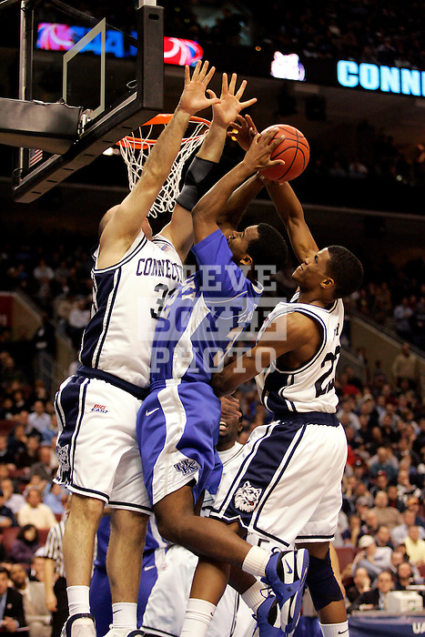 Kentucky guard Joe Crawford (32) shoots in between Connecticut forwards Ed Nelson (32) and Rudy Gay (22).  Connecticut defeated Kentucky 87-83 in the second round of the NCAA Tournament  at the Wachovia Center in Philadelphia, Pennsylvania on March 19, 2006.