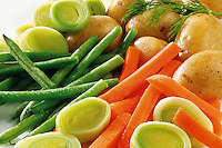 Fresh vegetables - green beans, carrots, leeks and potatoes. Food photos.