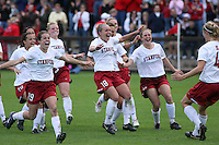 18 November 2007: Kristin Stannard, Kelley O'Hara, Alicia Jenkins, Shari Summers, Lizzy George, April Wall, and Rachel Buehler congratulate Allison Falk during Stanford's 1-1 double overtime shootout win over California in the second round of the NCAA Division 1 Women's Soccer Championships at Laird Q. Cagan Stadium in Stanford, CA.