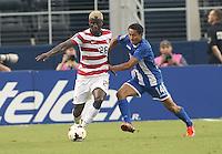 Eddie Johnson #26 of the USMNT in action against Andy Najar #14 of Honduras on July 24, 2013 at Dallas Cowboys Stadium in Arlington, TX. USMNT won 3-1.