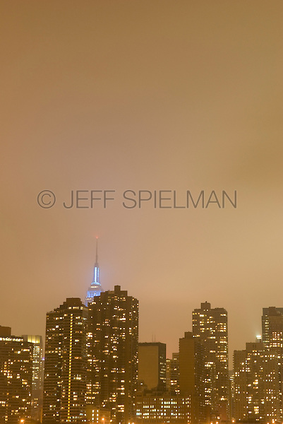 AVAILABLE FROM JEFF AS A FINE ART PRINT.<br /> <br /> AVAILABLE FOR COMMERCIAL AND EDITORIAL LICENSING FROM PLAINPICTURE.  Please go to www.plainpicture.com and search for image # p5690079.<br /> <br /> Detail of the Midtown Manhattan Skyline on an Overcast Night, Empire State Building Visible in the Distance, New York City, New York State, USA