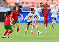 HOUSTON, TX - JUNE 10: Christen Press #23 of the United States brings the ball up the field while looking to pass it with Tatiana Pinto #11 of Portugal behind her during a game between Portugal and USWNT at BBVA Stadium on June 10, 2021 in Houston, Texas.