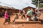 "CAR, Yelloke: Young peul ladies are taking water from the well of their village in Yelloke. After the crisis in CAR, the anti-balaka of Yelloke city have decided to build a village where the muslim minority, the Peuls, can live and be protected by the UN.  23th April 2016. <br /> <br /> RCA, Yelloke: Des jeunes femmes peuls prennent de l'eau du puis dans leur village de Yelloke. Après la crise de Centrafrique, les anti-balaka ont décid"" de construire un village pour la minorité musulmane, les peuls, où ils peuvent vivre et être protégés par l'UN.  23 avril 2016."