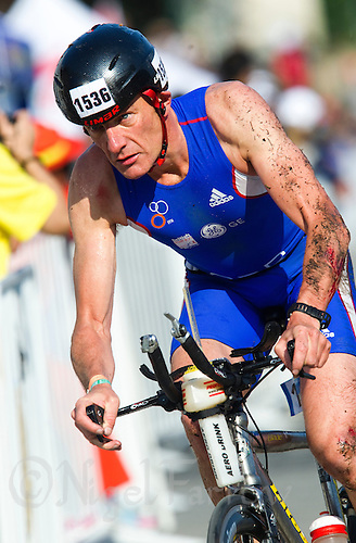 11 SEP 2011 - BEIJING, CHN - Simon Baldwin (GBR) shows signs of a fall during the bike at the 2011 ITU World Age Group Olympic Distance Triathlon Championships (PHOTO (C) NIGEL FARROW)