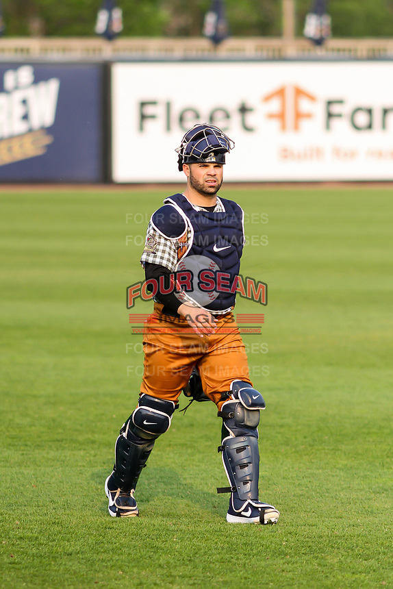 Milwaukee Brewers catcher Manny Pina (12) makes his way to the dugout prior to a rehab appearance with the Wisconsin Timber Rattlers in a Midwest League game against the Peoria Chiefs on May 31, 2019 at Fox Cities Stadium in Appleton, Wisconsin. Peoria defeated Wisconsin 3-0. (Brad Krause/Four Seam Images)