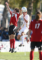 Perry Kitchen #5 of the University of Akron heads the ball away from Chase Rodgers #12 of the University of Louisville during the 2010 College Cup final at Harder Stadium, on December 12 2010, in Santa Barbara, California.Akron champions, 1-0.