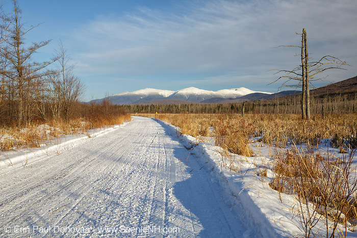 Scenic view of the Presidential Range snow-covered from along the Presidential Range Rail Trail (Cohos Trail) near Cherry Pond at Pondicherry Wildlife Refuge in Jefferson, New Hampshire. This trail utilizes the old railroad bed of the Boston & Maine's Berlin Branch, which was abandoned and removed in the 1990s.