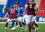 St Johnstone v Hearts...25.09.11   SPL Week 9.Kevin Moon is closed down by Adrian Mrowiec, David Obua, Ian Black and Andy Webster.Picture by Graeme Hart..Copyright Perthshire Picture Agency.Tel: 01738 623350  Mobile: 07990 594431