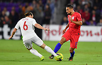 ORLANDO, FL - NOVEMBER 15: Samuel Piette #6 of Canada and Sebastian Lletget #17 of the United States battle for a ball during a game between Canada and USMNT at Exploria Stadium on November 15, 2019 in Orlando, Florida.