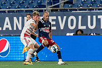 FOXBOROUGH, MA - AUGUST 21: Tiago Mendonca #33 of New England Revolution II passes the ball as Scott Thomsen #3 of Richmond Kickers defends during a game between Richmond Kickers and New England Revolution II at Gillette Stadium on August 21, 2020 in Foxborough, Massachusetts.