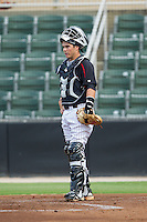 Kannapolis Intimidators catcher Brett Austin (10) on defense against the Charleston RiverDogs at CMC-NorthEast Stadium on June 27, 2014 in Kannapolis, North Carolina.  The Intimidators defeated the RiverDogs 6-5.  (Brian Westerholt/Four Seam Images)