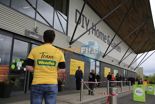 Queues outside the Woodies DIY store in drogheda on the first day of restrictions being lifted from the covet-19 pandemic. <br /> <br /> The Queue started before 8am with he store not opening until 9am. With only 30 people being let into the store at a time.<br /> <br /> Picture Fran Caffrey/Newsfile
