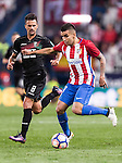 Angel Correa of Atletico de Madrid fights for the ball with Javi Marquez of Granada CF during their La Liga match between Atletico de Madrid and Granada CF at the Vicente Calderon Stadium on 15 October 2016 in Madrid, Spain. Photo by Diego Gonzalez Souto / Power Sport Images