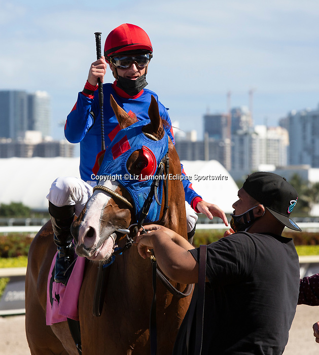 March 27, 2021: Churn N Burn #8, ridden by jockey Julien Leparoux, draws away from the field to win the Pan American Stakes (Grade 2) on Florida Derby Day at Gulfstream Park in Hallandale Beach, Florida. Liz Lamont/Eclipse Sportswire/CSM