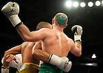 GLASGOW, SCOTLAND - MARCH 10: Gary O'Sullivan (green shorts) sports a Shamrock hair cut defeats of Paul Morby to win their Welterweight contest on the Ricky Burns undercard at the Braehead Arena on March 10, 2012 in Glasgow, Scotland. (Photo by Rob Casey/Getty Images)
