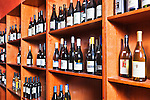 Wine on shelves and Open Wooden Cases of Wine.  White wine and red wine. .