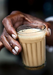 A chai wallah ( tea man) mixes up the traditional sweet brew on the streets  in New Delhi's Sundar Nagar. An enclave full of jewellery stores, tea houses and antiques shops it is a magnet for tourists looking for the unique Indian gift and local well heeled residents to shop.