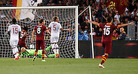 Calcio, Serie A: Roma vs Milan. Roma, stadio Olimpico, 25 aprile 2014.<br /> AS Roma forward Gervinho, of Ivory Coast, second from left, scores during the Italian Serie A football match between AS Roma and AC Milan at Rome's Olympic stadium, 25 April 2014.<br /> UPDATE IMAGES PRESS/Riccardo De Luca