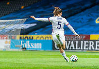 SOLNA, SWEDEN - APRIL 10: Kelley O'Hara #5 of the USWNT dribbles during a game between Sweden and USWNT at Friends Arena on April 10, 2021 in Solna, Sweden.