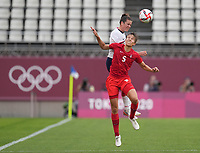 KASHIMA, JAPAN - AUGUST 2: Kelley O'Hara #5 of the United States heads the ball over Quinn #5 of Canada during a game between Canada and USWNT at Kashima Soccer Stadium on August 2, 2021 in Kashima, Japan.