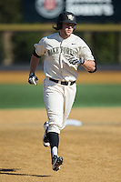 Will Craig (22) of the Wake Forest Demon Deacons rounds the bases after hitting the first of two 3-run home runs on the day against the Richmond Spiders at David F. Couch Ballpark on March 6, 2016 in Winston-Salem, North Carolina.  The Demon Deacons defeated the Spiders 17-4.  (Brian Westerholt/Four Seam Images)