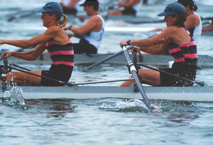 Rowing, women rowing a double racing shell, Master's National Championship Regatta, Lake Onondaga, Syracuse, New York,  1996, Olivia Montgomery (bow), Kate Stegemoeller, (stroke) at the drive.