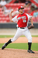Relief pitcher Greg Atencio #33 of the Carolina Mudcats in action versus the Birmingham Barons at Five County Stadium August 16, 2009 in Zebulon, North Carolina. (Photo by Brian Westerholt / Four Seam Images)