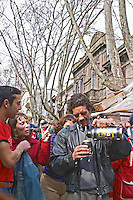 People on the street at the market drinking mate herbal tea from a cup carrying a thermos warm water flask Montevideo, Uruguay, South America