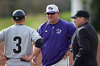 High Point Panthers head coach Craig Cozart (center) meets with Campbell Camels head coach Justin Haire (3) and home plate umpire Tony Carilli prior to their Big South baseball game at Williard Stadium on March 16, 2019 in  Winston-Salem, North Carolina. The Camels defeated the Panthers 13-8. (Brian Westerholt/Four Seam Images)