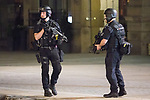 © Joel Goodman - 07973 332324 . 23/05/2017. Manchester, UK. Armed police search and clear Cathedral Gardens ahead of carrying out a controlled explosion . Police and other emergency services are seen near the Manchester Arena after reports of an explosion. Police have confirmed they are responding to an incident during an Ariana Grande concert at the venue. Photo credit : Joel Goodman