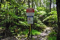 Captains trail warning sign and emergency helipad sign, Kahaualea Natural Reserve, Puu Oo vent, Kilauea volcano, Hawaii, USA Volcanoes National Park, Big Island of Hawaii, USA