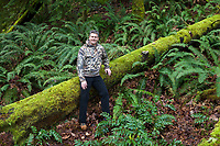 Photographer Kenny Williams Leaning Against Moss Covered Fallen Tree, Cascade Mountain Range, Washington, USA.