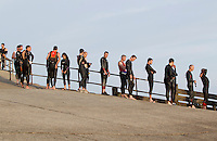 27 JUL 2013 - CROMER, GBR - Competitors queue for race numbering before the swimstart of The Anglian Triathlon from  West Runton to Cromer, North Norfolk, Great Britain  (PHOTO COPYRIGHT © 2013 NIGEL FARROW, ALL RIGHTS RESERVED)
