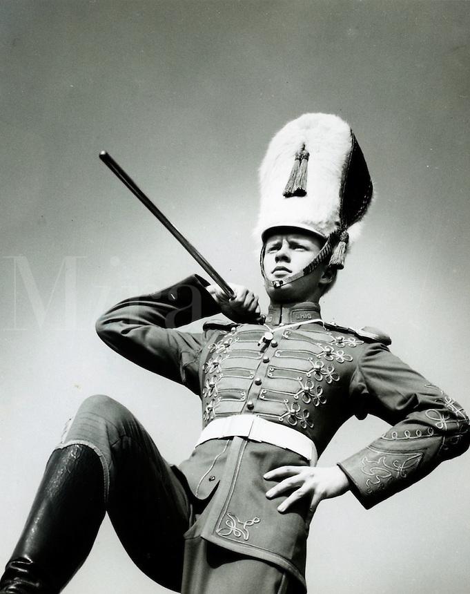 Drum major strutting in parade. 1950's.<br />