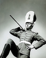 Drum major strutting in parade. 1950's.<br />