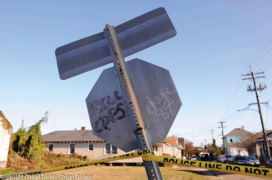 """Kill Cops"" graffiti on stop sign at murder scene, 7th Ward, 2014"