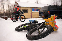 Fat-tire bikes are the name of the game at the headquarters of the 200-mile Iditasport Human Powered Race in Knik, Alaska. The 2014 event is a revival of the legendary 1980's race, which was the first of its kind to put foot and bicycle power to the test against a trail normally only traversed by dogsled or snowmachine. The original competition paved the way for other endurance races in the far north and spurred a number of innovations in outdoor equipment, including the now-ubiquitous fat tire bicycle.