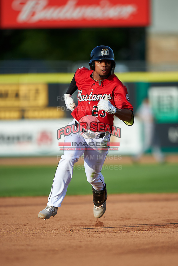 Billings Mustangs Reniel Ozuna (23) runs to third base during a Pioneer League game against the Grand Junction Rockies at Dehler Park on August 15, 2019 in Billings, Montana. Billings defeated Grand Junction 11-2. (Zachary Lucy/Four Seam Images)