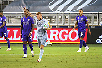KANSAS CITY, KS - SEPTEMBER 23: Johnny Russell #7 of Sporting Kansas City retrieves the ball from the Orlando goal after scoring during a game between Orlando City SC and Sporting Kansas City at Children's Mercy Park on September 23, 2020 in Kansas City, Kansas.