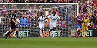 Pictured: Bafetimbi Gomis of Swansea protest to match referee C Pawson (L)<br /> Re: Premier League match between Crystal Palace and Swansea City at Selhurst Park on Sunday 24 May 2015 in London, England, UK
