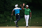 Anirban Lahiri (r) of India high fives fellow player Chikkarangappa S. of India during round four of the 2016 Venetian Macao Open at Macau Golf and Country Club on October 16, 2016 in Macau, China. Photo by Marcio Machado / Power Sport Images