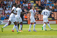Dwight Gayle of Crystal Palace (3rd left) celebrates scoring his team's first goal to make it 1-1 during the Friendly match between Barnet and Crystal Palace at The Hive, London, England on 11 July 2015. Photo by David Horn.